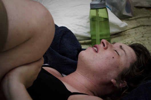 Jackie Askvig (mother) in labor, lying on her back to reposition