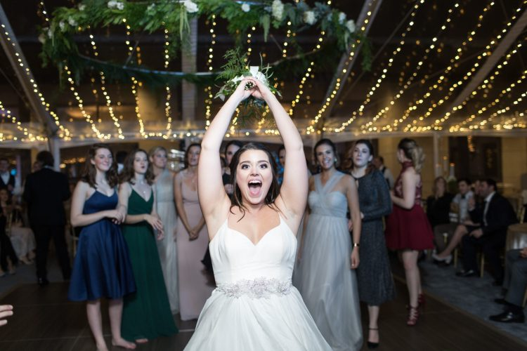 utah bride throwing bouquet to bridesmaids