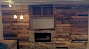 Rustic basement fireplace pallet wall