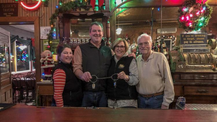Deb Cairns hands the Sleder's keys to her son, Ryan Cox: (L-R) Megan Cox, Ryan Cox, Deb Cairns, and Brian Cairns,