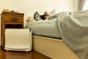 how close should a humidifier be to your bed