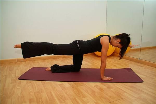 Alternating arm and leg plank