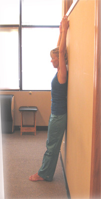 Arms can remain by your sides as well. Let the spine slide upwards against the wall, stretcing towards the ceiling. Enjoy taller posture!