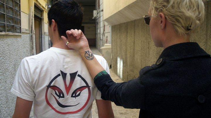 Vandari shirt and tattoo