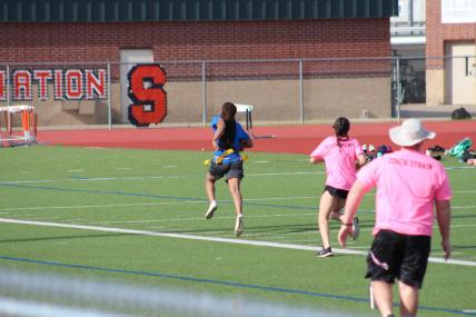 Jada Lake brakes up the sideline for a touchdown. This score put the blue team ahead of the pink team.