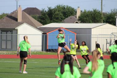 Brooke Bigott goes up for a ball. Now on offense, Brooke's reception moved the ball closer to the in-zone.