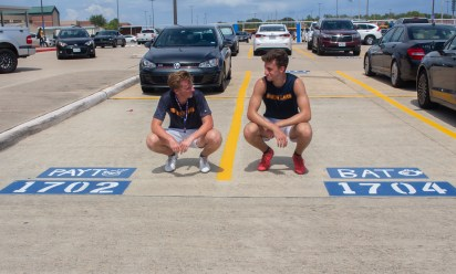 After running marathons during seventh period soccer, seniors Payton Dally and Brian Tripsa meet up at their parking spots before going home for the day. Dally and Tripsa bought spots next to because they were close friends and wanted spots near the soccer field.