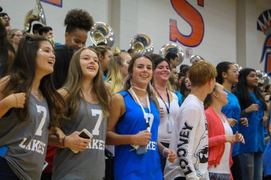 Cheerleaders, Bella Carr, Callie Bexley, and Hayden Smith cheer with the band.