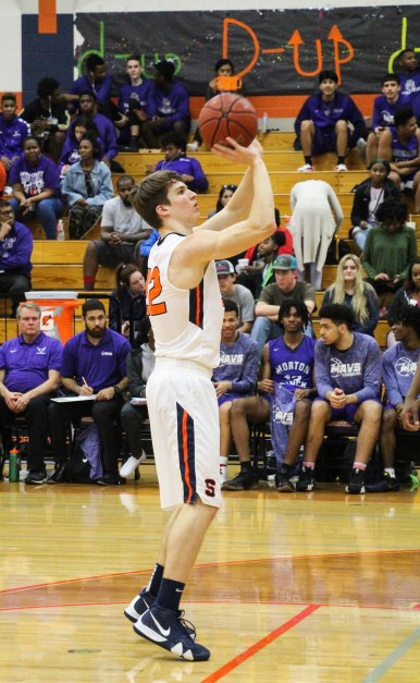 Senior Brett Kerr is at the line for a free throw. Many players practice free throws on a daily basis to improve their free throw percentage.