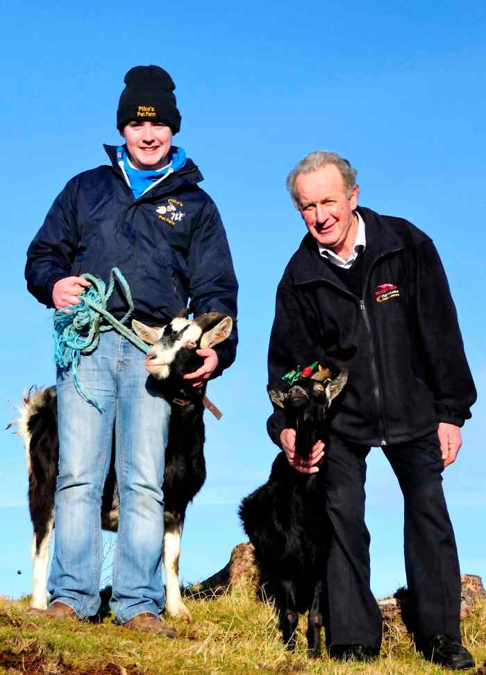 Jack Pilkington from Pilko's Pet Farm, Daingean, Offaly with his goat Nelly and Johnny Rigney, Chairman of Slieve Bloom Association with Ginny. Ginny was passing the crown to Nelly for Imbolc 'Milking of the goat' Festival 2015 at Spink Hill near Cadamstown, Offaly on Sunday 1st February.