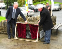 Liam Murray and Paddy Heaney unveil the Paddy Lowry Plaque