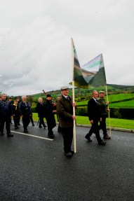 Marching into Kinnitty with the Slieve Bloom Association banner.