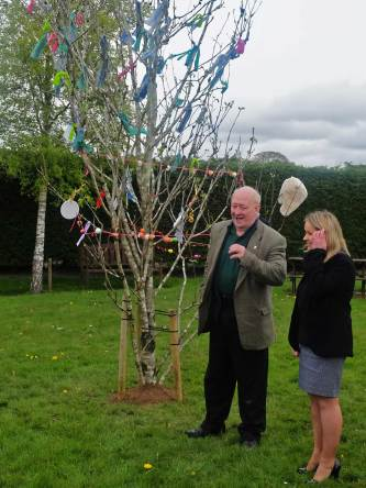 Slieve Bloom Association Chairperson Carol Nolan TD listens as Mick Dowling describes the ancient Bealtine customs around the May Bush