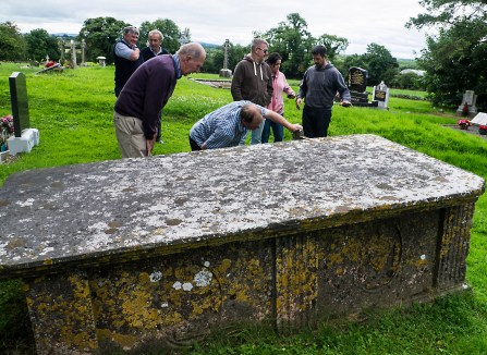 Examining the carvings on a tomb at Cloneenagh on the Slieve Bloom Ard Eireann Festival bus tour 2016 - Photo, Kathleen Culliton