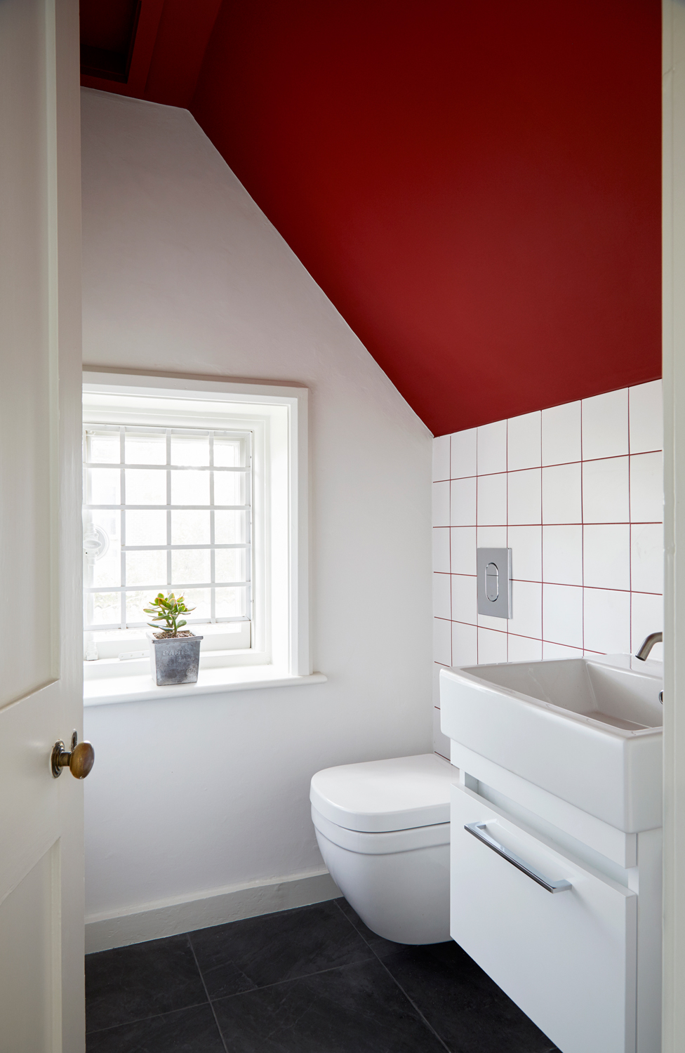 cloakroom with white tiles and red grout, red ceiling