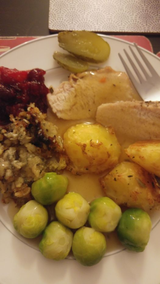 Traditional Chrismas dinner - roasted potatoes, turkey, stuffing, brussel sprouts, with gravy, cranberry sauce and pickles