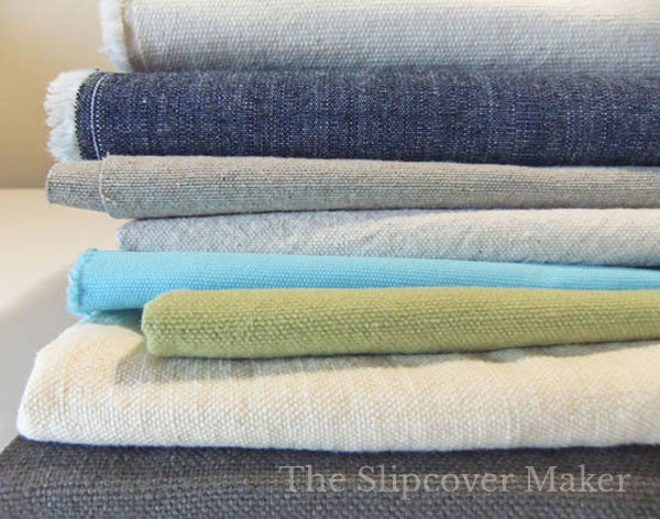 Stack of canvas slipcover fabrics.