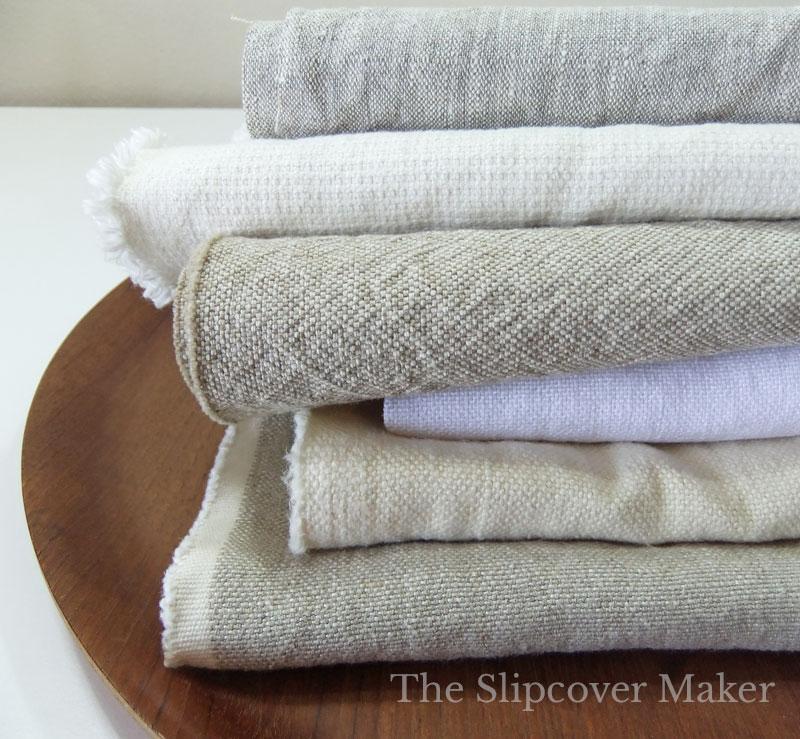 Stack of linen slipcover fabrics.