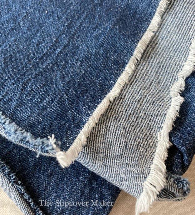 Washed indigo blue denim fabric sample.