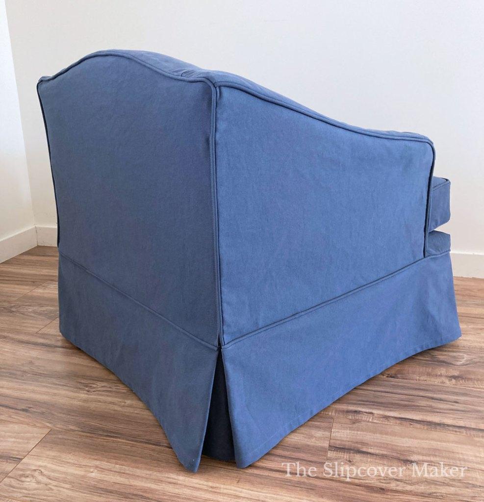 Back corner zipper on blue chair slipcover.
