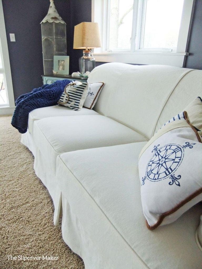 Big white sofa slipcover at lake house.