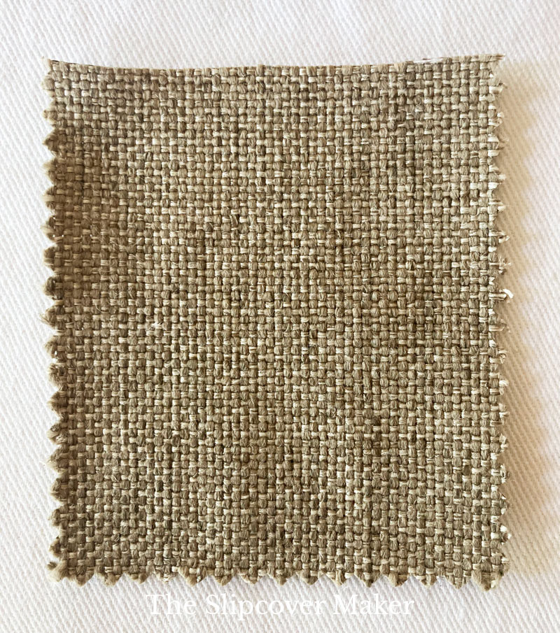 Brown fabric swatch with grainy weave.