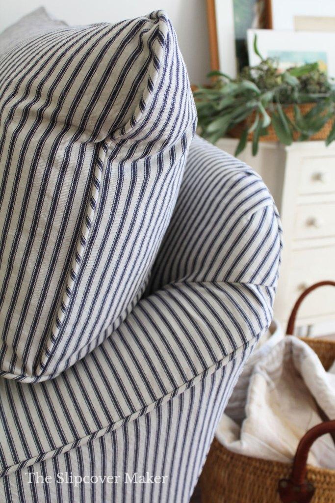 Plump blue and white stripe chair cushion.