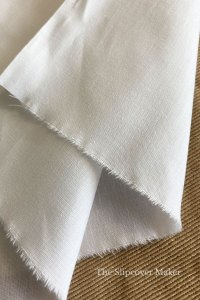 White polyester and cotton slipcover lining fabric.