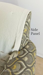 Shaping slipcover fabric around chair side panel.