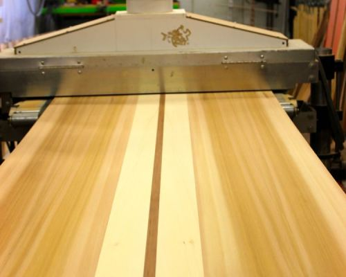 Sanding a paddle board panel
