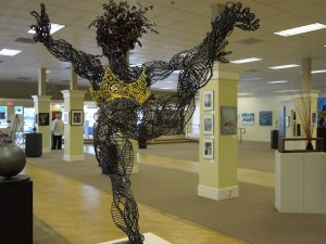 """Yellow Girl"" by Evany Zirul, made of welded steel and recycled clothes"