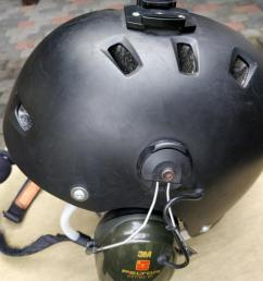 powered flying helmet with many scratches from moderate use left earmuff visible  [ 1280 x 1152 Pixel ]