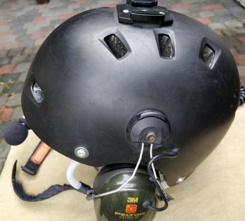 small resolution of powered flying helmet with many scratches from moderate use left earmuff visible