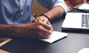 man writing a list