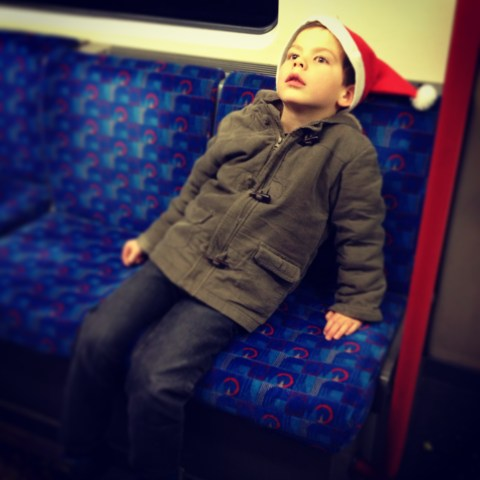 After a long evening of revelry, a tired Isaac kicks back on the tube