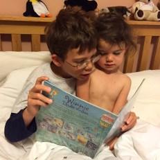 Isaac reading to Kara