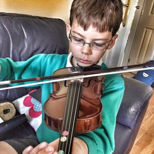 Isaac playing the viola