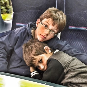 isaac-toby-train-cuddle
