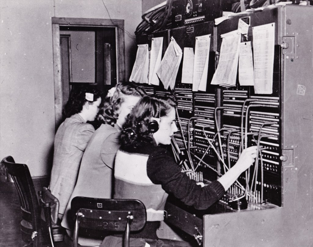 Fort Richardson telephone operators Hilda Dahler, Arlys Berggren and Ruthie Duguid connect calls in 1950. The operators use the fort's first switchboard, which was based on a field tactical model. Source: Wikimedia Commons