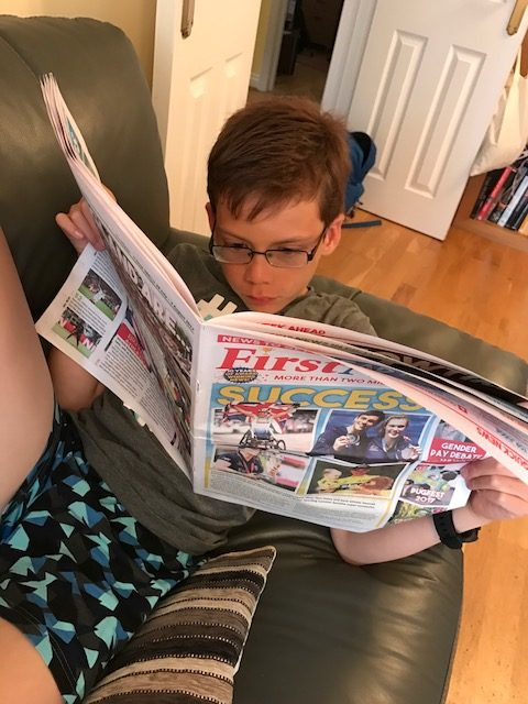 Isaac's 10th birthday letter reading newspaper