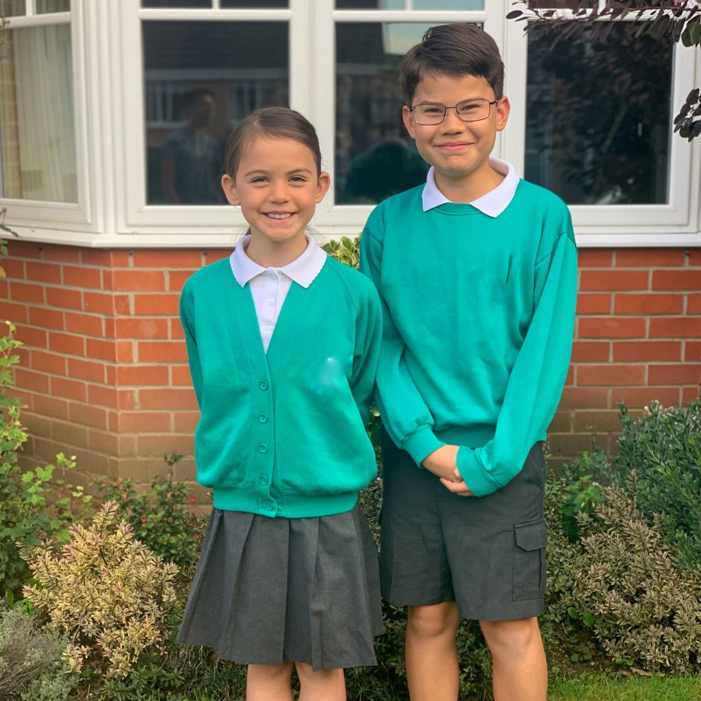 A girl and a boy standing in school uniform