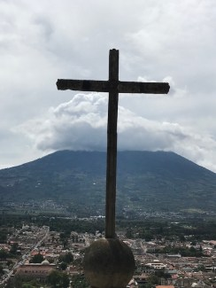 cross with volcano