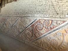 el brujo painted reliefs