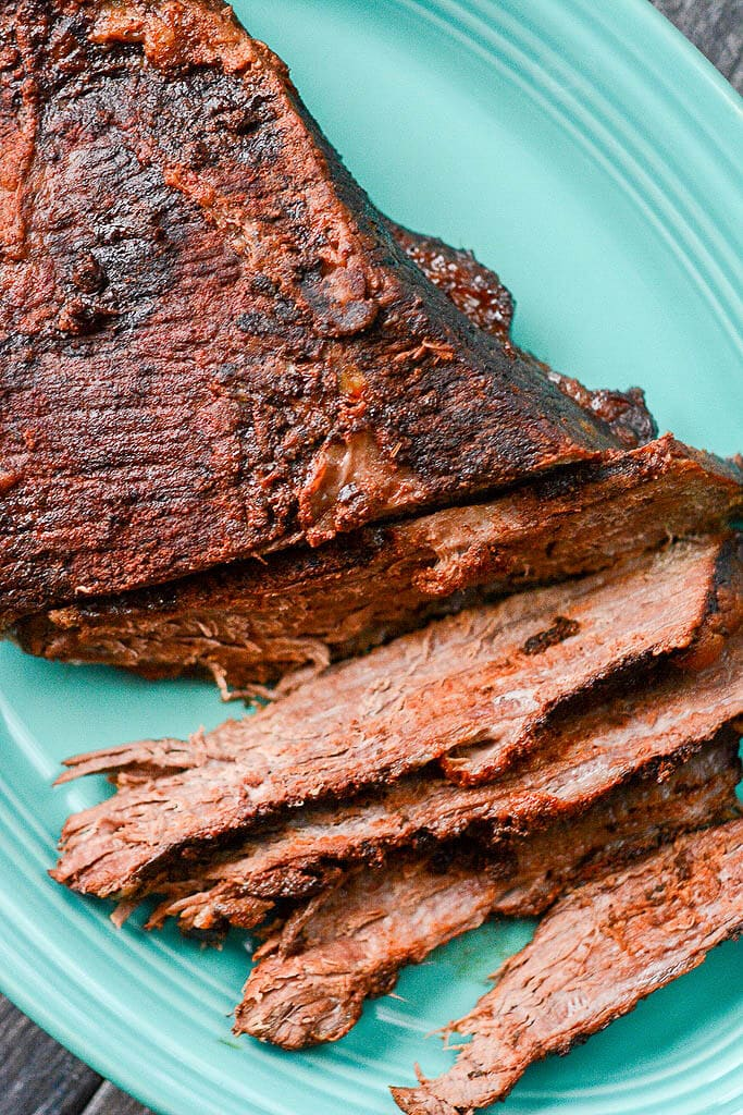 Cooked brisket on a platter - Slow Cooker Beer Braised Brisket