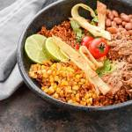 When you're ready to take your dinners from boring to amazing, these Slow Cooker Pork Enchilada Bowls will make it easy!