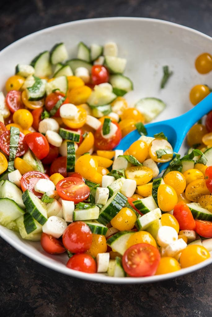 Looking for an easy lunch box idea for work or school? This Cucumber Tomato Salad with Mozzarella is the perfect solution! You can even include in your meal prep plan and eat delicious all week!