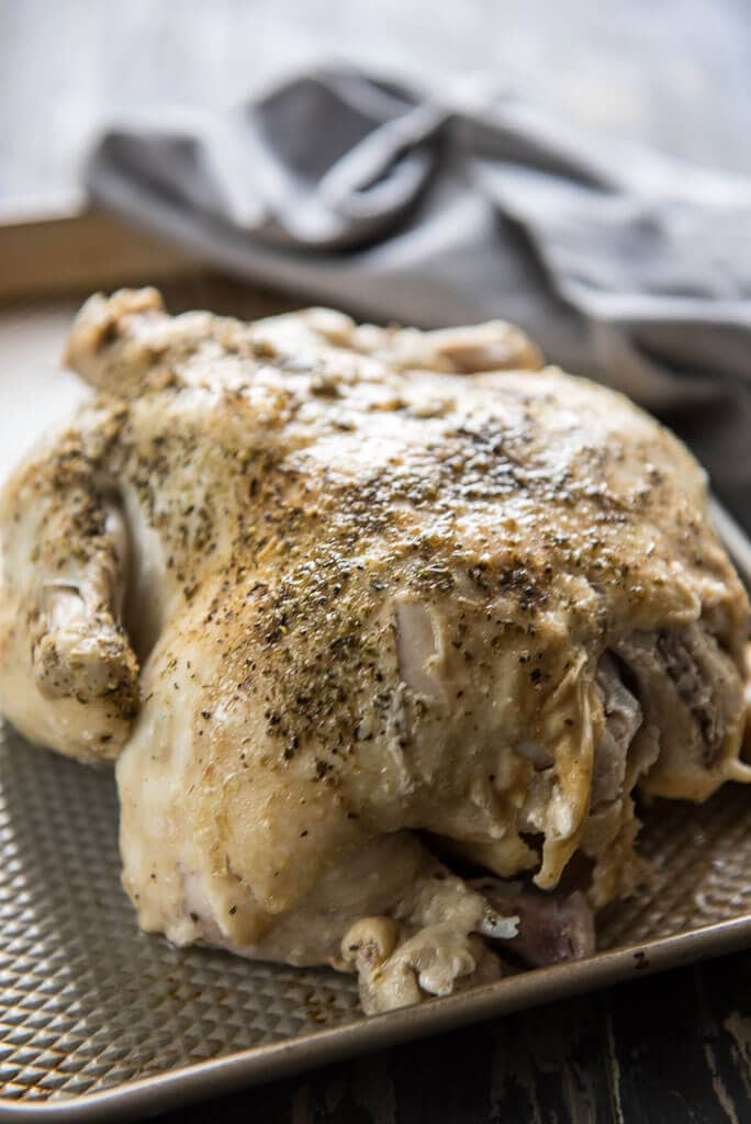 Instant Pot Whole Chicken with seasonings on baking sheet ready to shred