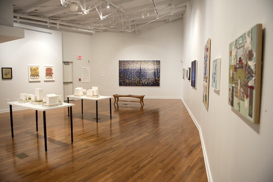 """The rich blue and gold of Stoltzfus' large, painted abstractions draw viewers into the gallery 