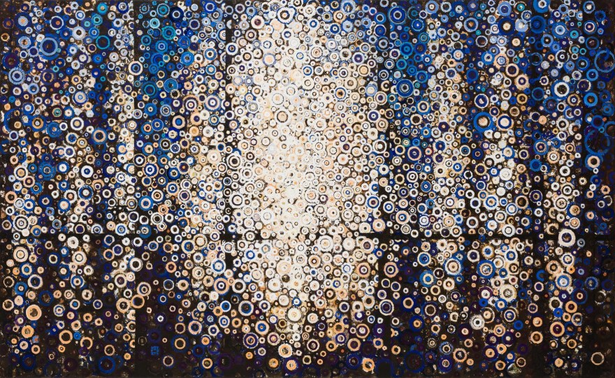 "Dark vertical bands interspersed with blue gold and white circular marks invoke light in a forest in the painting ""Clear"" by Randall Stoltzfus, 2014, acrylic dispersion on polymer canvas, 37 by 60 inches"