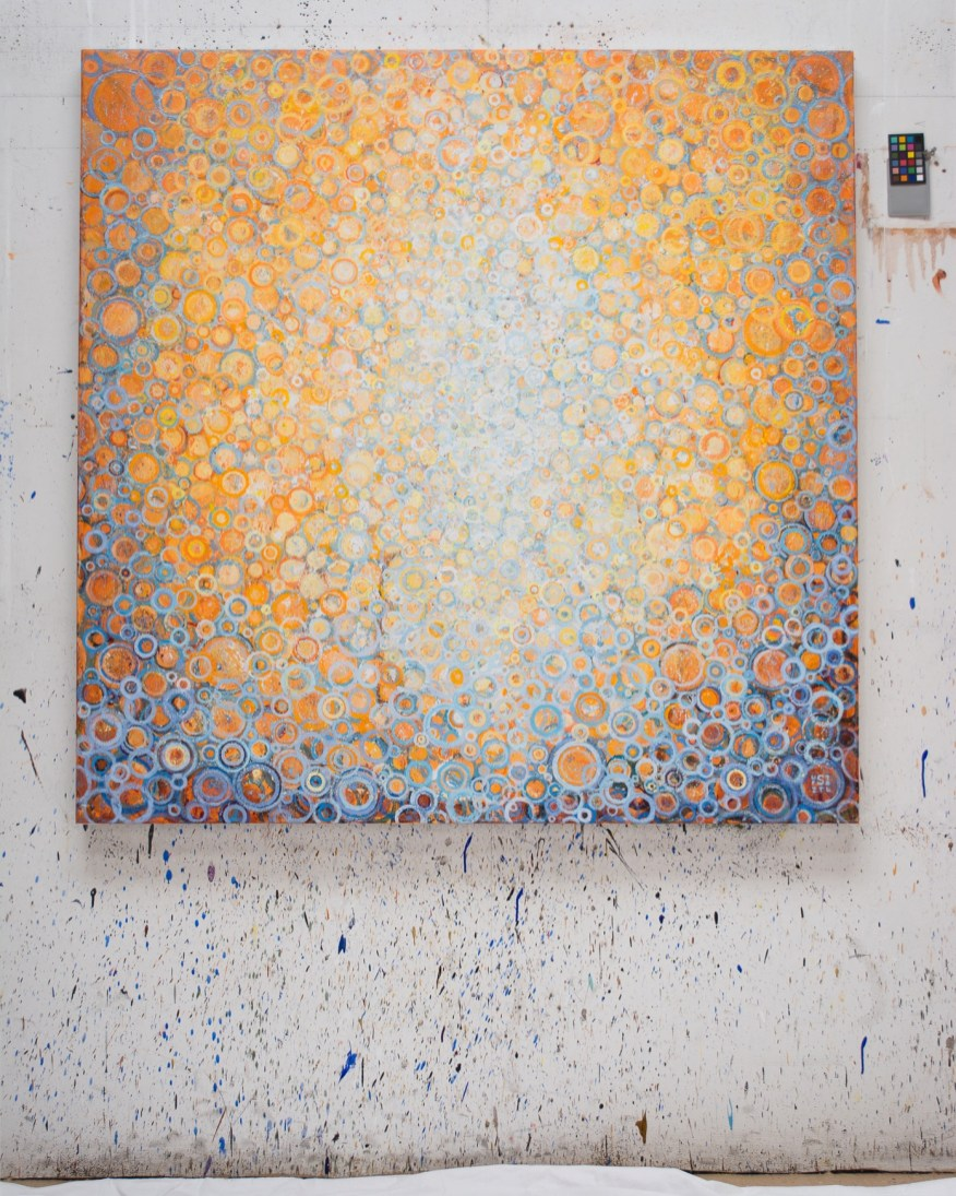 "Orange and blue | Completed commissioned painting titled ""Seek"" by Randall Stoltzfus hangs on paint-spattered wall of the artist's Brooklyn studio"